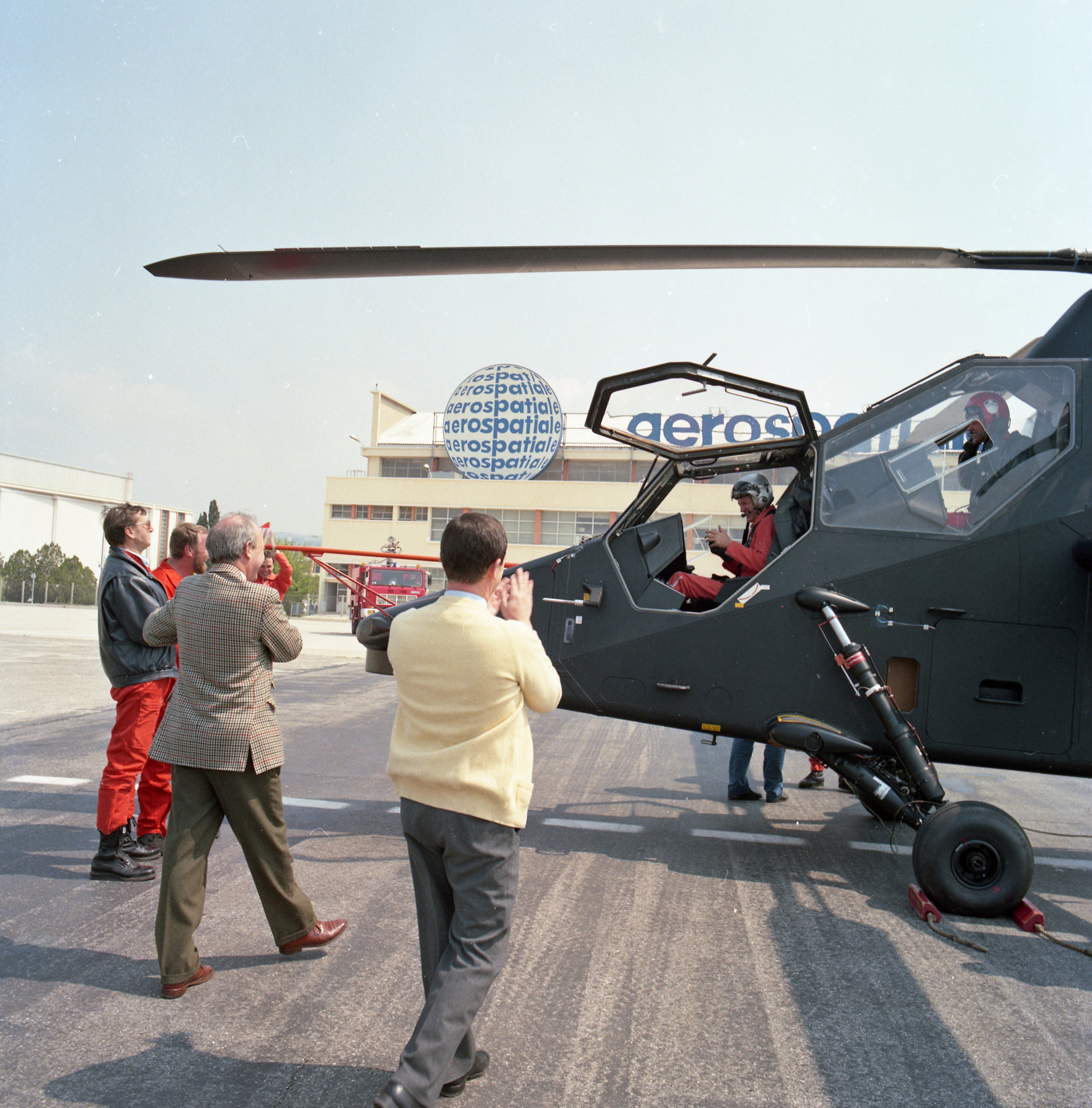 Media members take photos after the conclusion of the Tiger combat helicopter's maiden flight.