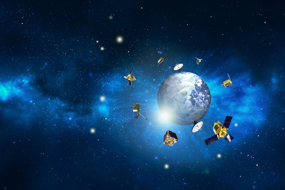 An artist's representation of multiple Airbus-built Earth observation satellites orbiting the planet.
