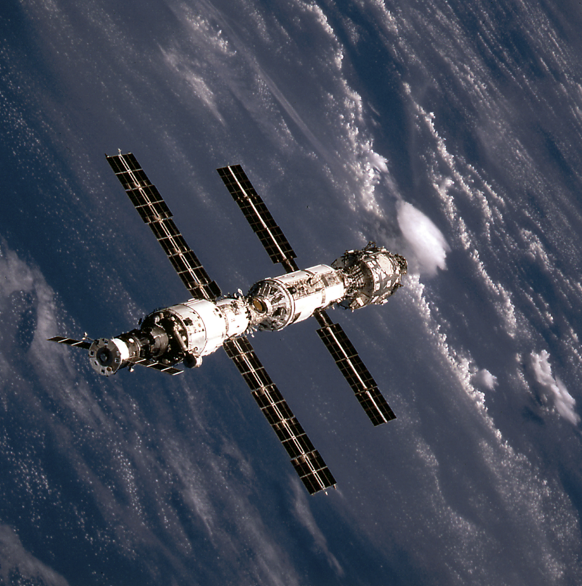 This image of the International Space Station (ISS) was taken when Space Shuttle Atlantis (STS-106 mission) approached the ISS for docking. At the top is the Russian Progress supply ship that is linked with the Russian-built Service Module (Zvezda). The Zvezda is connected with the Russian-built Functional Cargo Block (FGB or Zarya). The U.S.-built Node 1 or Unity module is seen at the bottom. – Credit: NASA (STS 106 was in Sept. 2000)