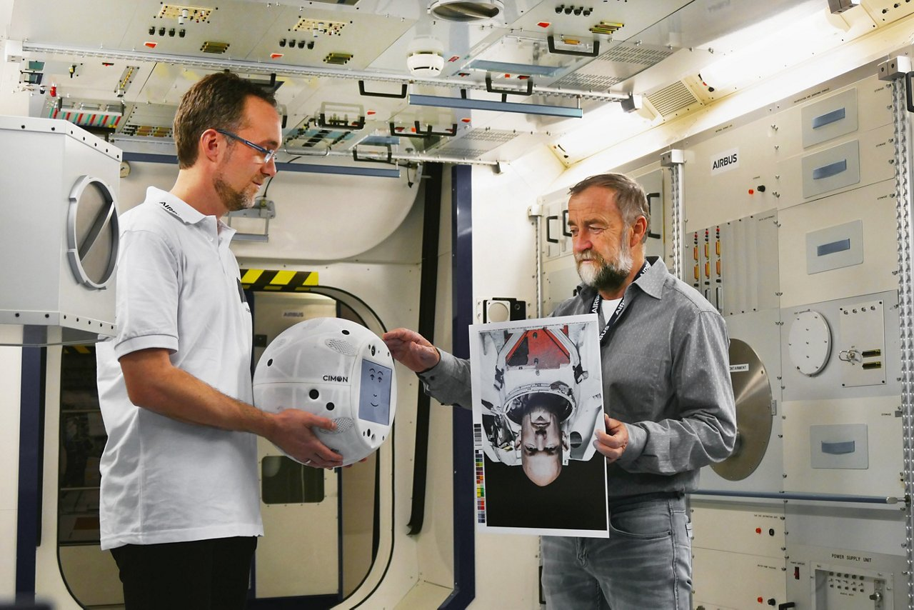 Identifying Alexander Gerst - CIMON Project Manager Till Eisenberg (left) and Josef Sommer, CIMON GNC Team Leader at Airbus are testing CIMON with images of Astronaut Alexander Gerst