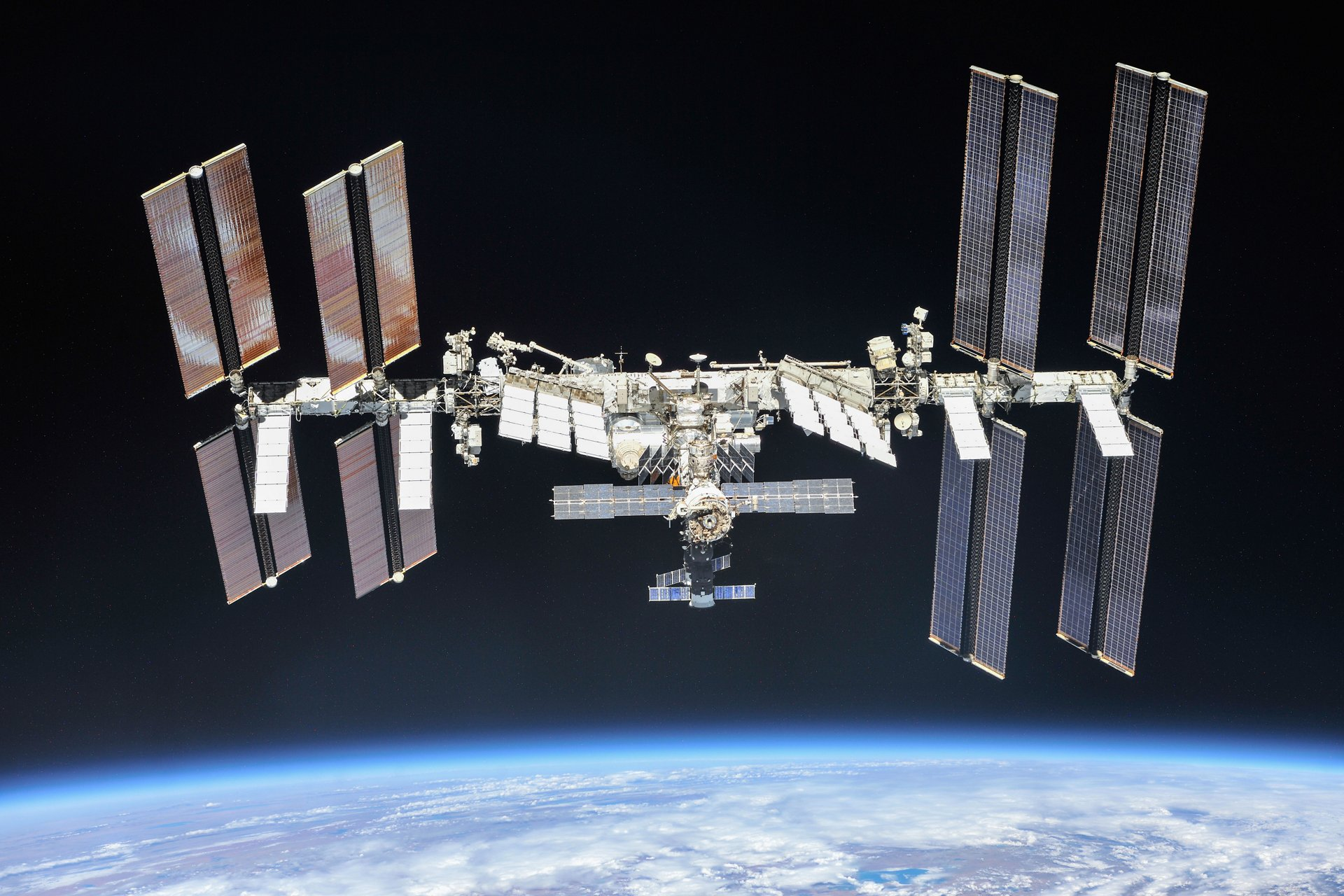 The International Space Station photographed by Expedition 56 crew members from a Soyuz spacecraft after undocking. NASA astronauts Andrew Feustel and Ricky Arnold and Roscosmos cosmonaut Oleg Artemyev executed a fly around of the orbiting laboratory to take pictures of the station before returning home after spending 197 days in space. The station will celebrate the 20th anniversary of the launch of the first element Zarya in November 2018. Credit: NASA