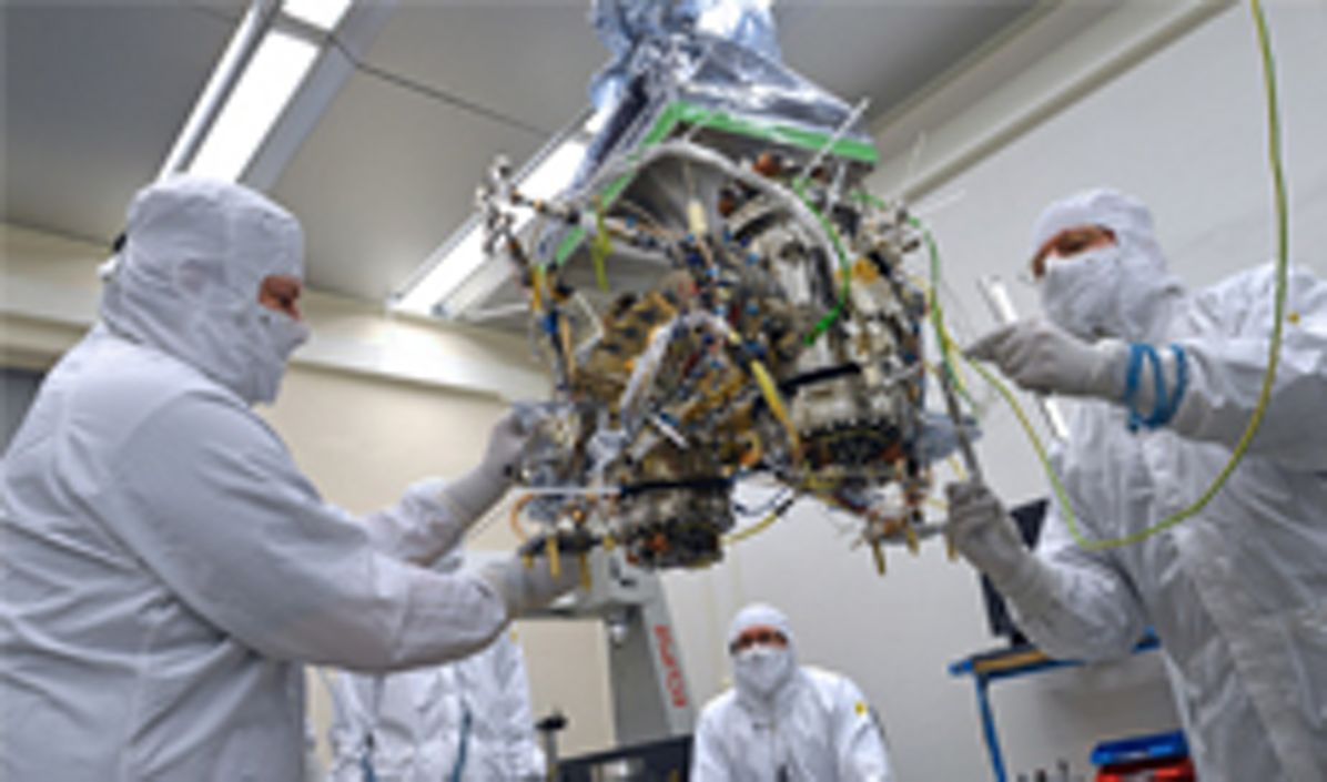 Airbus employees working on a  space instrument