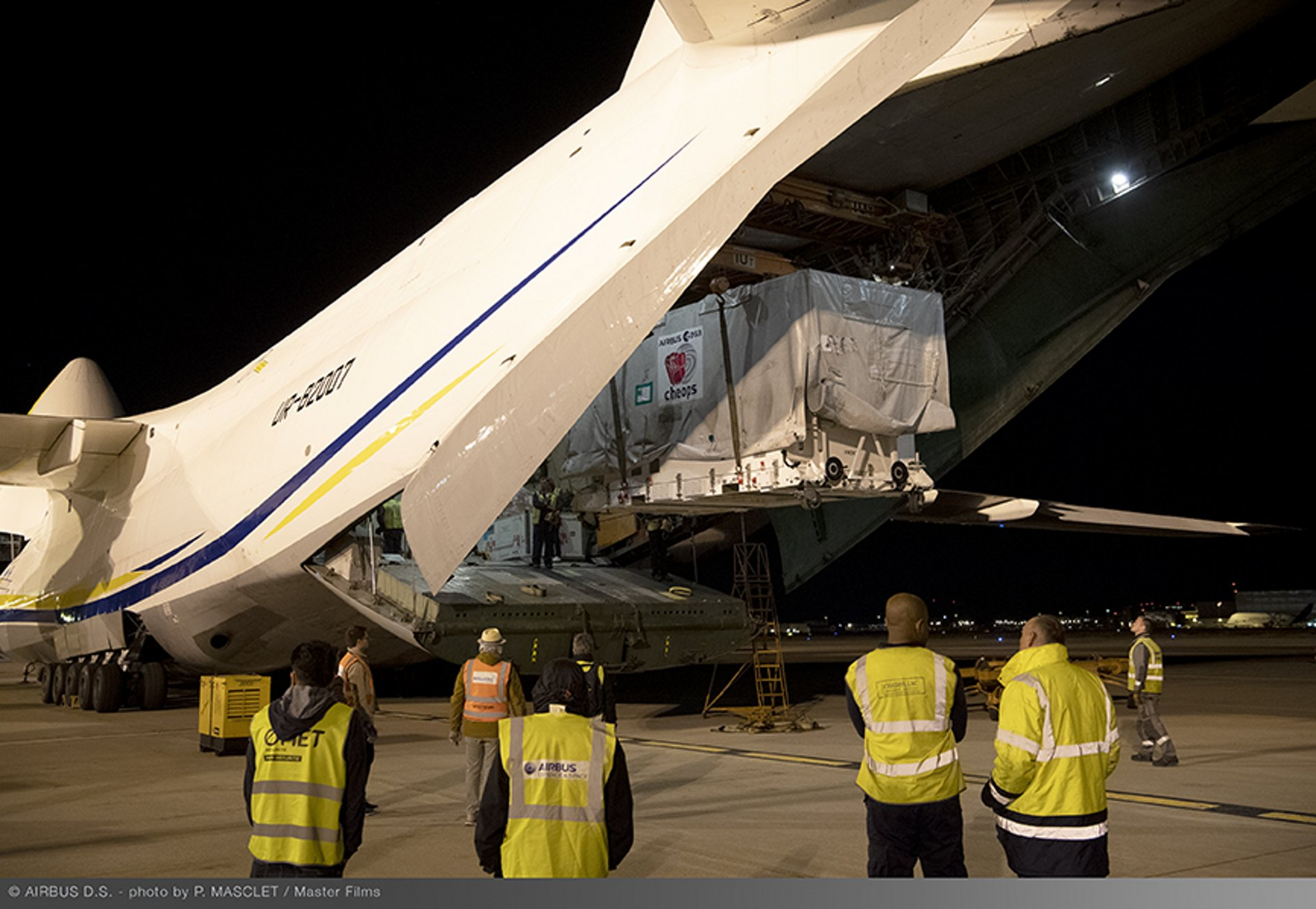 CHEOPS' container is being loaded into the Antonov freighter, along with another Airbus satellite