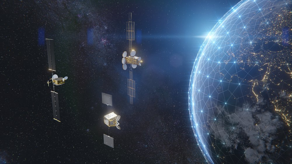 A computer rendering showing three Airbus-produced OneSat satellites orbiting Earth.