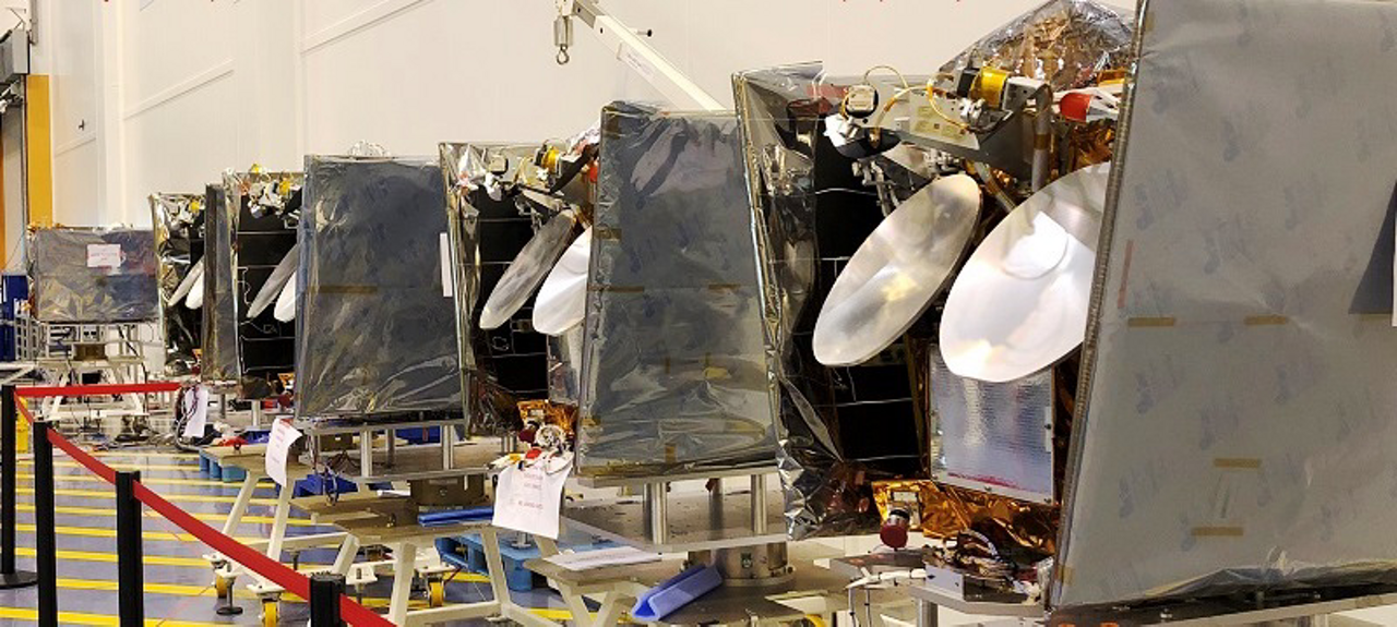 The first batch of Airbus-produced OneWeb satellites is lined up for transport to the launch site.