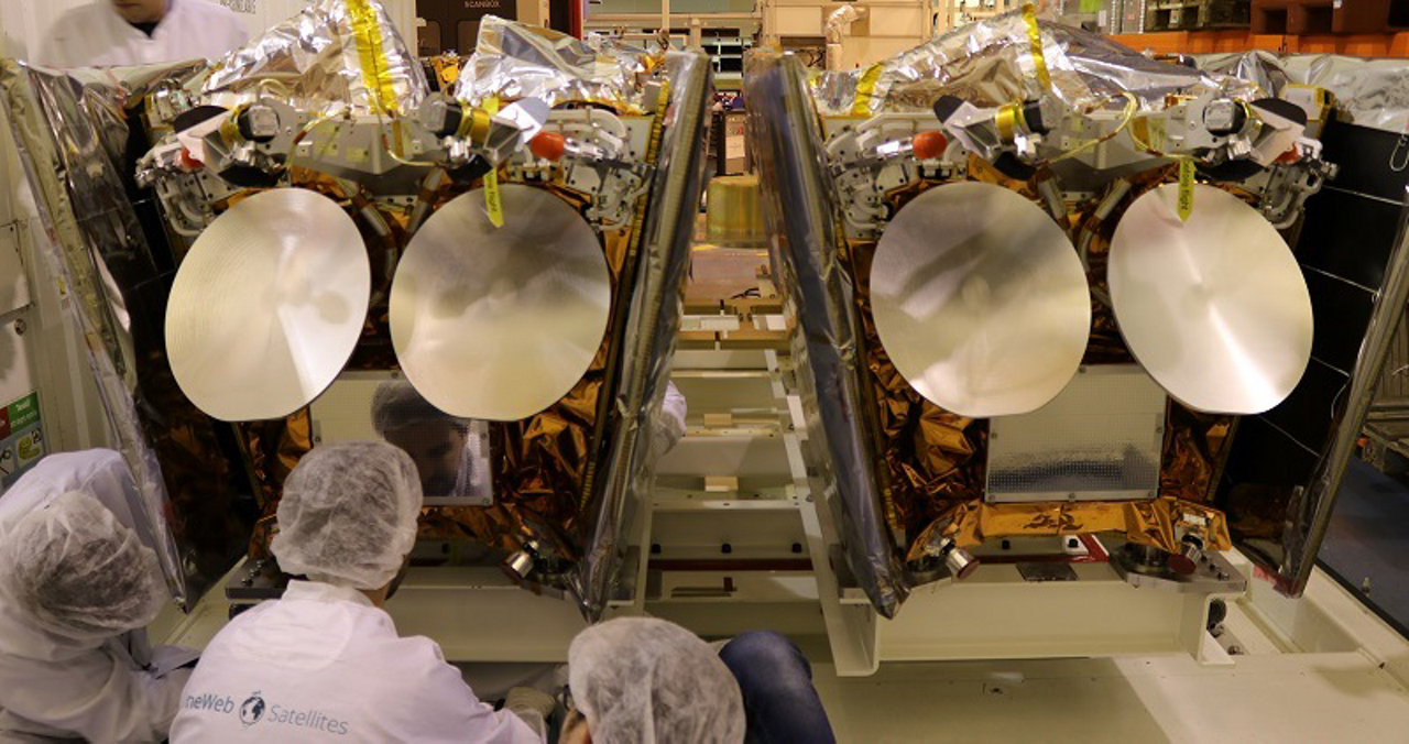 An engineer's view of two Airbus-produced OneWeb satellites being prepared for transport to the launch site.