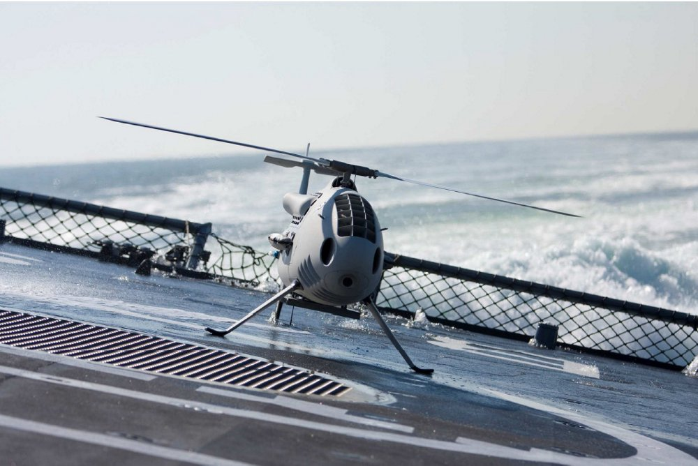 An unmanned aerial vehicle lands on a pitching and rolling ship deck equipped with the Deckfinder local positioning system.