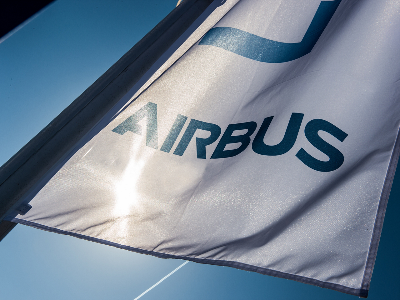 The Airbus logo as shown on a waving flag.